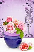 Pink roses in stacked ceramic bowls