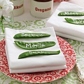 Place tags hand-made from mangetout with names written in white on place setting