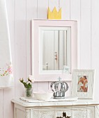Mirror with hand-crafted crown on top of frame