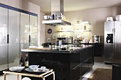 Spacious fitted kitchen with island counter and glossy fronts