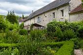 Stone house in summery garden