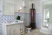 Traditional bathroom with cylindrical stove and blue and white wall tiles