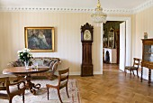 Interior with antique, Biedermeier furniture, oil painting and long-case clock