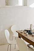 Rustic wooden table in white, modern kitchen