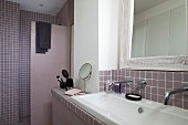 Mauve bathroom with wall-mounted taps, sinks, shower area and vintage mirror