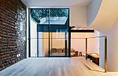 View from wooden platform into sunken living room