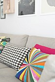 Colourful and patterned scatter cushions on ecru sofa