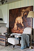 Vintage standard lamp, antique armchair and oil painting of horse