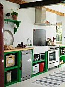 Rustic kitchen with functional counter and green-painted base units