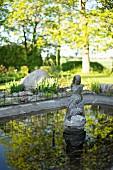 Stone statue in garden pond