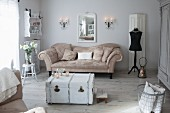 White vintage trunk and antique sofa in vintage-style interior
