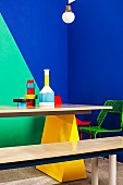 Painted wall, furniture and arrangement of vases in bold combination of colours