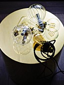 Various light bulbs on shiny gold panel