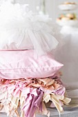 Romantic cushions in front of a buffet table
