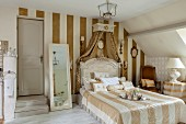 Elegant attic bedroom with striped wallpaper and traditional ambiance
