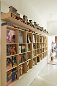 Hand-crafted wooden bookcase with collection of vintage toasters on top