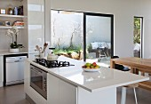 White island counter with gas cooker in open-plan interior