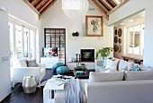 Pale sofa set in living room with partially exposed bamboo roof structure