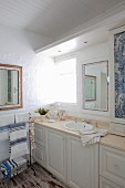 Blue and white bathroom with panelled base units