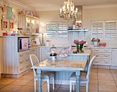Dining area and chandelier in cream kitchen