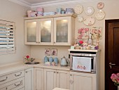 Cream kitchen with pastel accessories