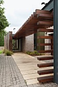 Walkway covered by modern steel and wood structure