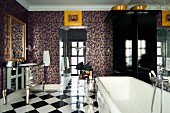 Ornamental wallpaper and chequered floor in glamorous bathroom