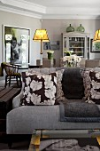 Elegant sofa and dining area in shades of grey
