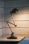 Loft Zick-Zack lamp on bedside table in corner of wood-clad room