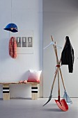 DIY wooden bench, coat stand made from disused gardening tools and pendant lamp made from hard hat