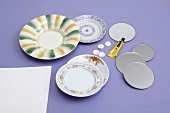Decorative wall plates made from old china, round mirrored coasters and premade eyelets
