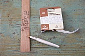 A roll of paper ribbon for labelling a gift