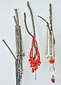 Necklaces of colourful beads hung from branches