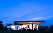 Modern house at night with illuminated interior