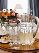 Vintage-style water jug and elegant stemware on tray
