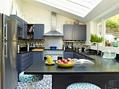 Black fitted kitchen with projecting counter