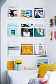 Books on wall-mounted shelves in colourful reading corner