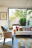 Summery living room with bright furniture, open patio door