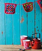 Teapot, beakers and pot holders