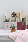 Cutlery and kitchen utensils sorted into hand-made and hand-painted cutlery boxes