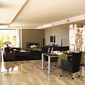 Dining table set with runners in front of dark seating area in open-plan designer interior