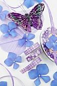 Blue still-life arrangement with hydrangea florets