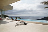 Purist ambiance on sun terrace with infinity pool and panoramic sea view