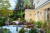 Garden furniture on terrace outside French country house