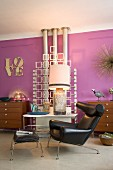Purple wall, objets d'art and Ox Chair in retro living room