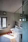 Washstand with countertop basin and mirrored cabinet in modern bathroom