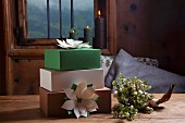 Hand-made festive paper flowers decorating gift boxes