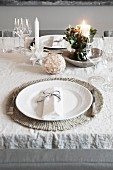 Place setting on festively set dining table