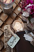 Birch bark place mat, name cards and lit tealight