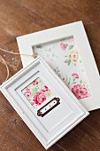 Hand-made pictures with rose motifs